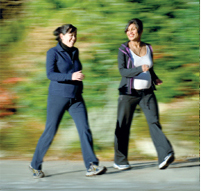 two pregnant women walking